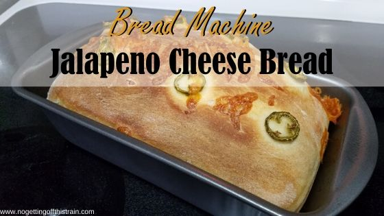 "Image of a bread loaf in a loaf pan with the title ""Bread machine jalapeno cheese bread"""