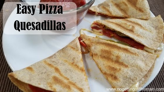 "Image of pizza quesadillas on a plate with the title ""Easy Pizza Quesadillas"""