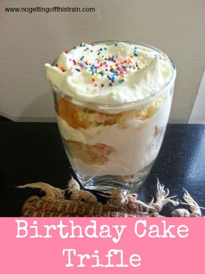 This Birthday Cake Trifle is layered with confetti cake and vanilla whipped icing topped with rainbow sprinkles! Great for any birthday party! www.nogettingoffthistrain.com