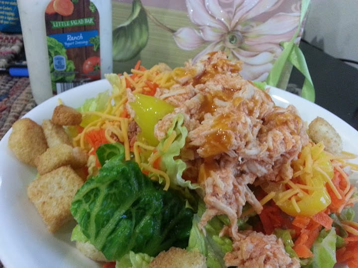 This yummy slow cooker buffalo chicken is great on top of salads or in a wrap! www.nogettingoffthistrain.com