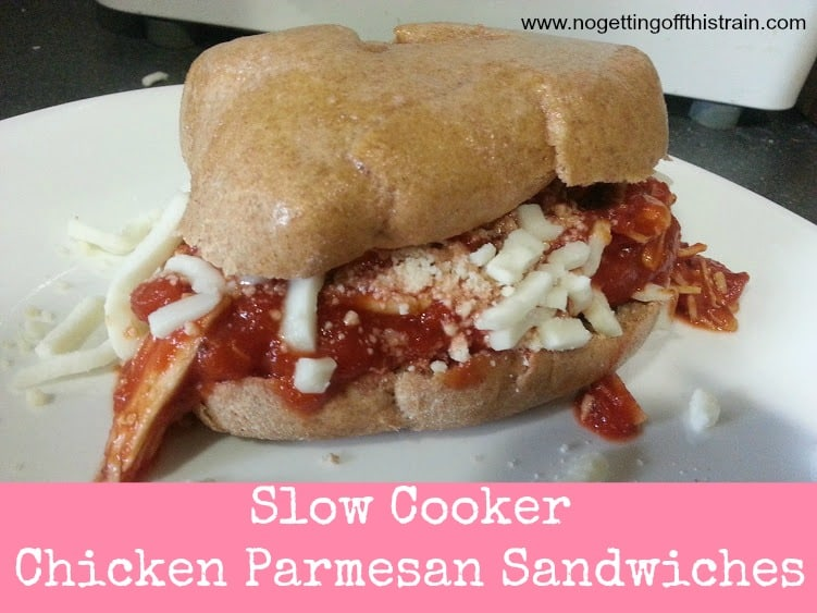 These slow cooker chicken parmesan sandwiches leave TONS of leftovers and can double as an extra meal! www.nogettingoffthistrain.com