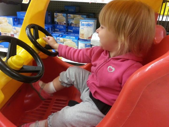 """Allison LOVES the """"car-car"""" cart at Kroger."""
