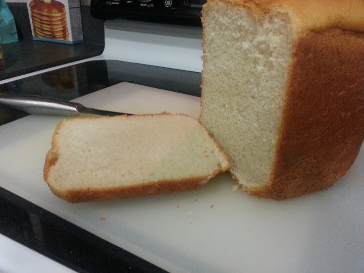 This delicious, soft and fluffy white bread is made in the bread machine and uses only a few ingredients! www.nogettingoffthistrain.com