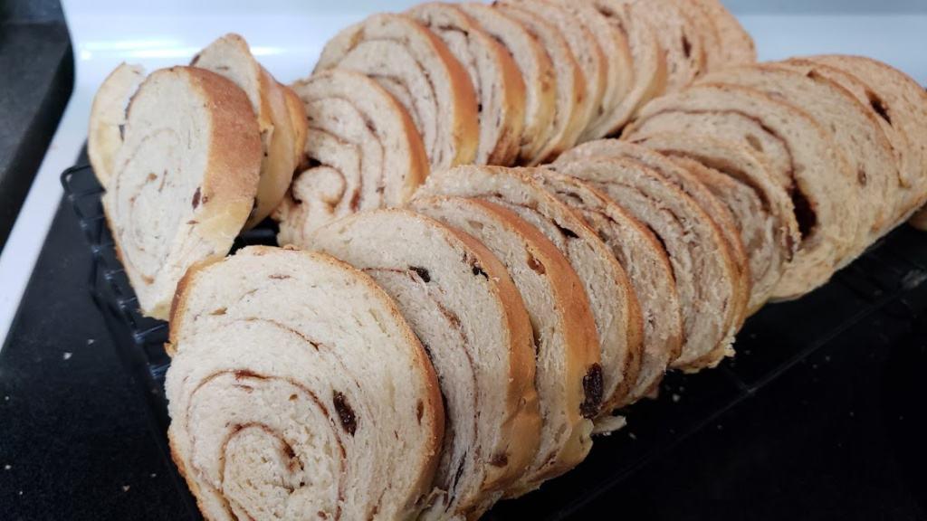 Sliced cinnamon raisin bread on a cooling rack