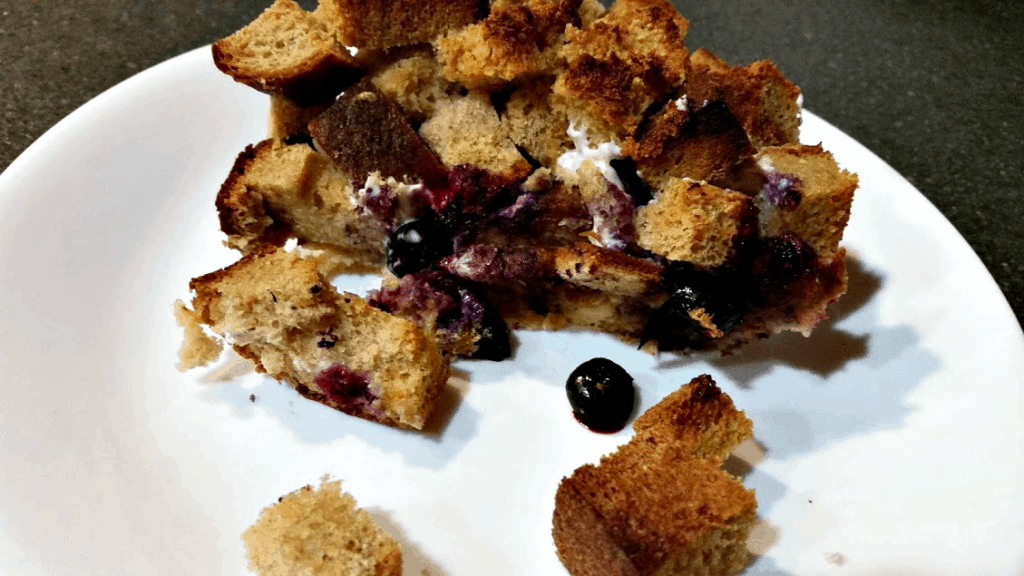 An easy, delicious breakfast that feeds a ton, this overnight blueberry cheesecake french toast casserole is sure to please! Great for busy mornings! www.nogettingoffthistrain.com
