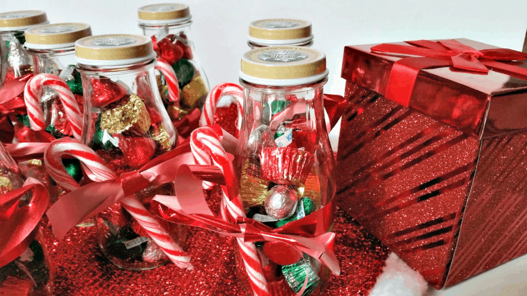 Fill an empty Starbucks Frappuccino bottle with candy as a Christmas gift! A great frugal gift idea for friends and neighbors. www.nogettingoffthistrain.com