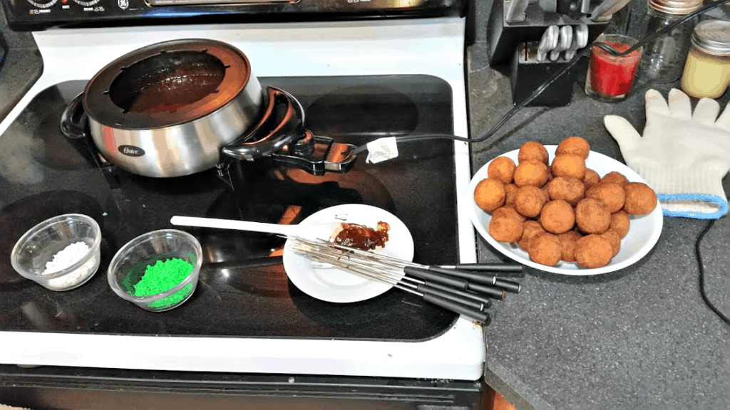 A fun idea for breakfast! Donut fondue- dip donut holes in chocolate and cover with sprinkles. www.nogettingoffthistrain.com