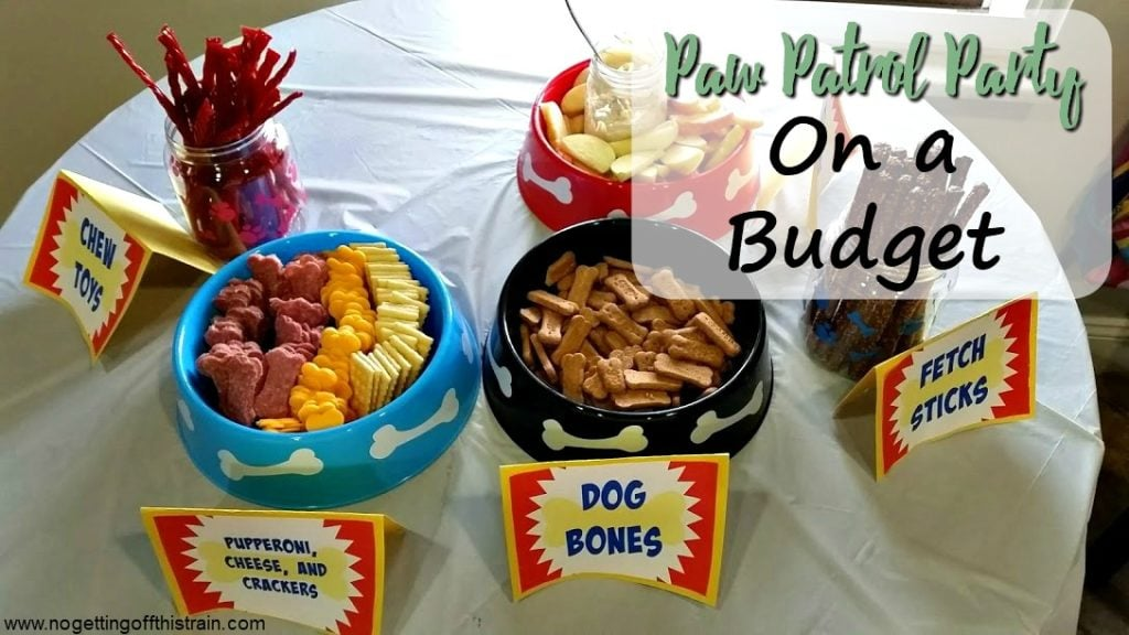 "Image of dog themed party food with the title ""Paw Patrol Party on a Budget"""