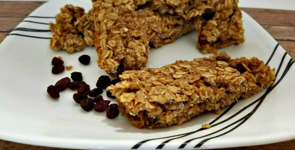 These Homemade Oatmeal Raisin Granola Bars are healthier and cheaper than store-bought! A great frugal snack, and kid friendly too!
