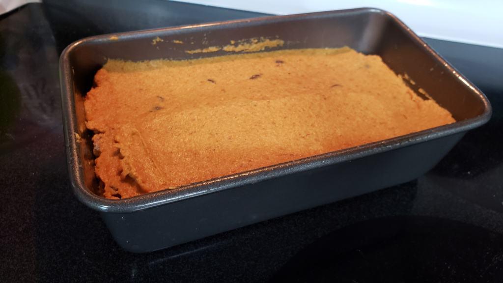 Unbaked pumpkin bread dough in a loaf pan