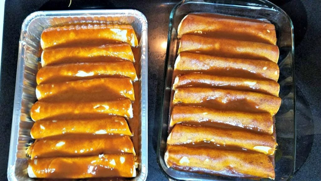 Looking for a large, easy freezer meal? These Red Chicken Enchiladas are a delicious Mexican dinner and can easily be doubled!