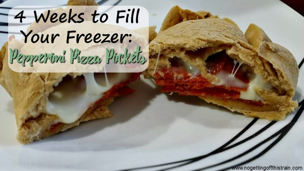 "Image of pepperoni pizza pocket cut in half with the title ""4 Weeks to Fill Your Freezer: Pepperoni Pizza Pockets"""