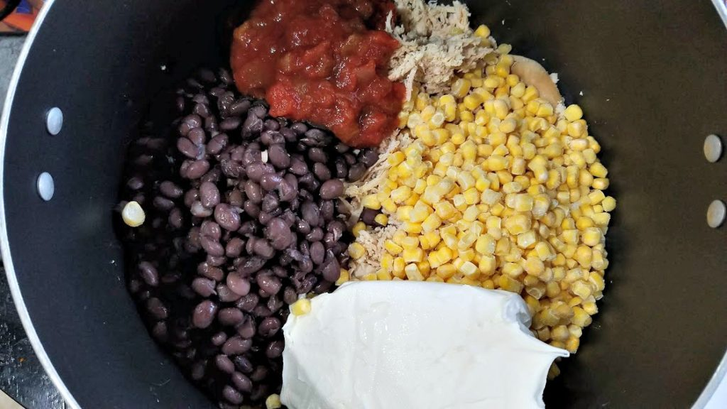 Image of shredded chicken, corn, black beans, salsa, and cream cheese in a pot