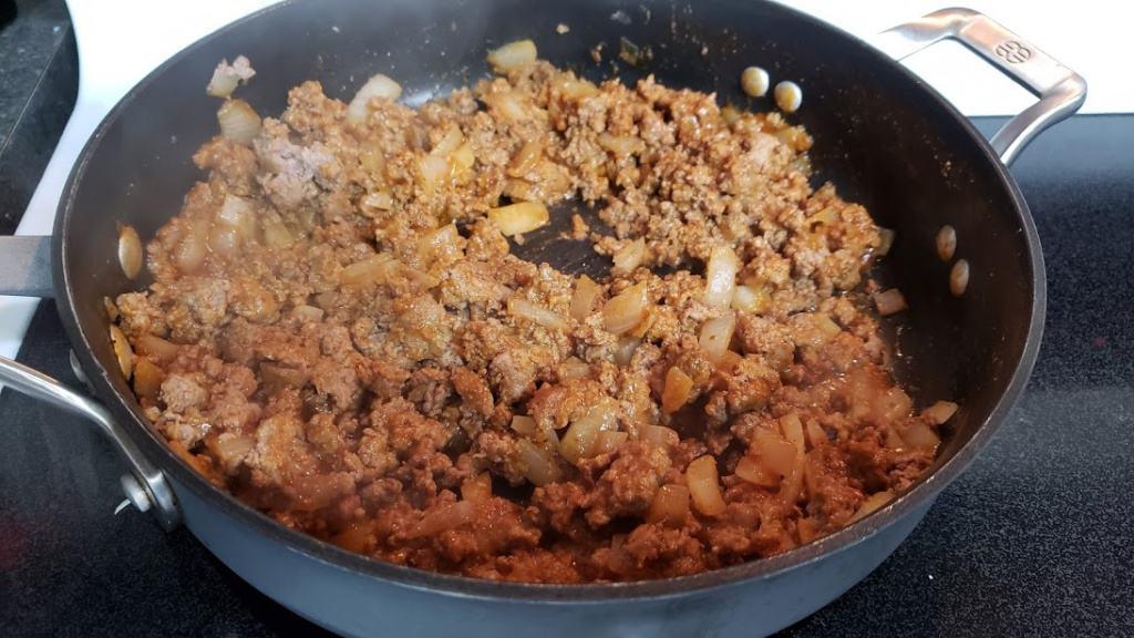 Cooked Sloppy Joe mixture in a pan