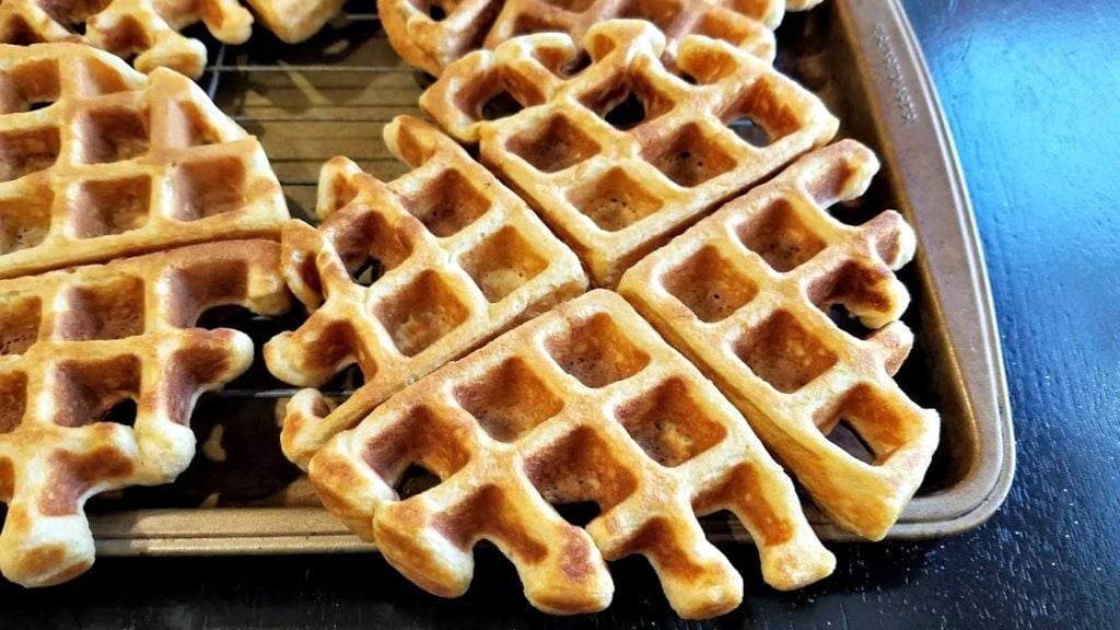 A close-up image of a waffle on a tray