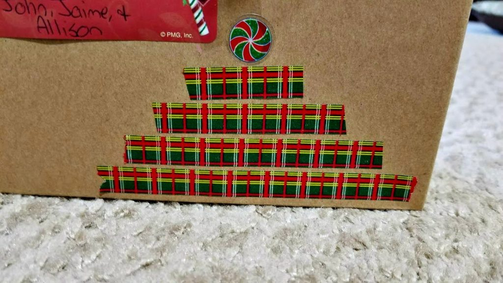 Get creative this holiday season! Here's how to use washi tape to decorate gifts and accent them with Kraft paper and Christmas stickers too!