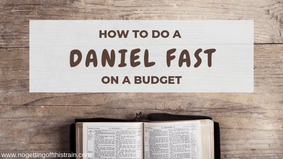 "Image of an open bible with the title ""How to do a Daniel Fast on a Budget"""