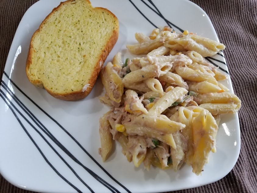 Image of a pasta casserole and garlic bread