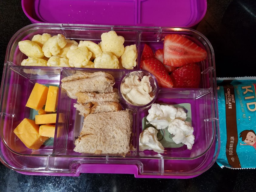 Image of a Yumbox lunch box with a lunch packed inside