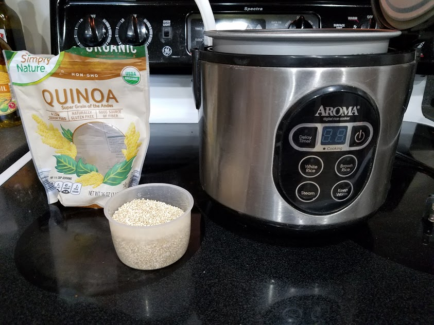Image of uncooked quinoa next to a rice cooker