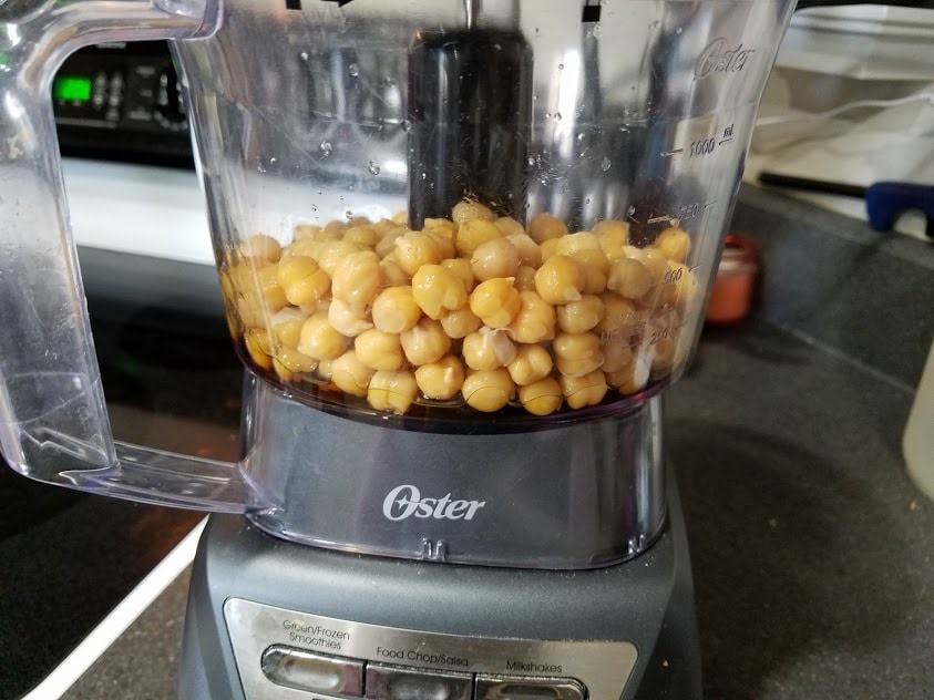 Image of chickpeas and maple syrup in a food processor