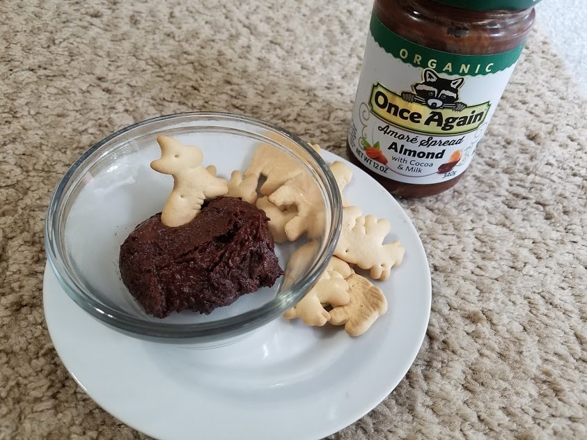 Image of chocolate hummus dip with animal crackers and a jar of Once Again Amore Almond Spread