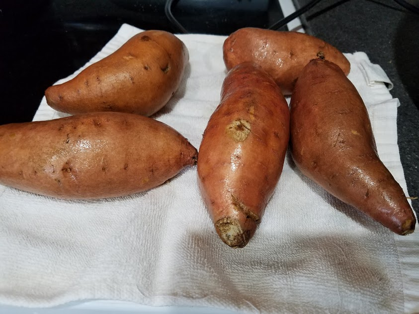 Image of whole washed sweet potatoes