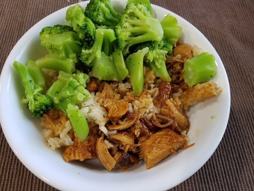 Image of a bowl filled with honey garlic chicken, rice, and broccoli