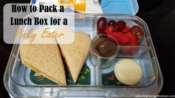 "Picture of a school lunchbox filled with food with the title ""How to pack a lunch box for a picky eater"""