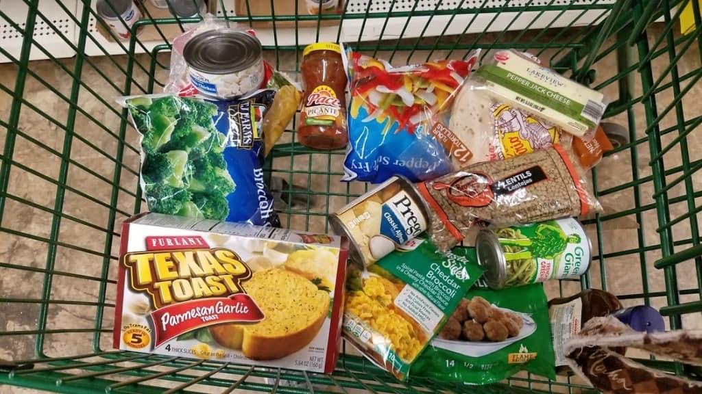 Image of a shopping cart of food at Dollar Tree