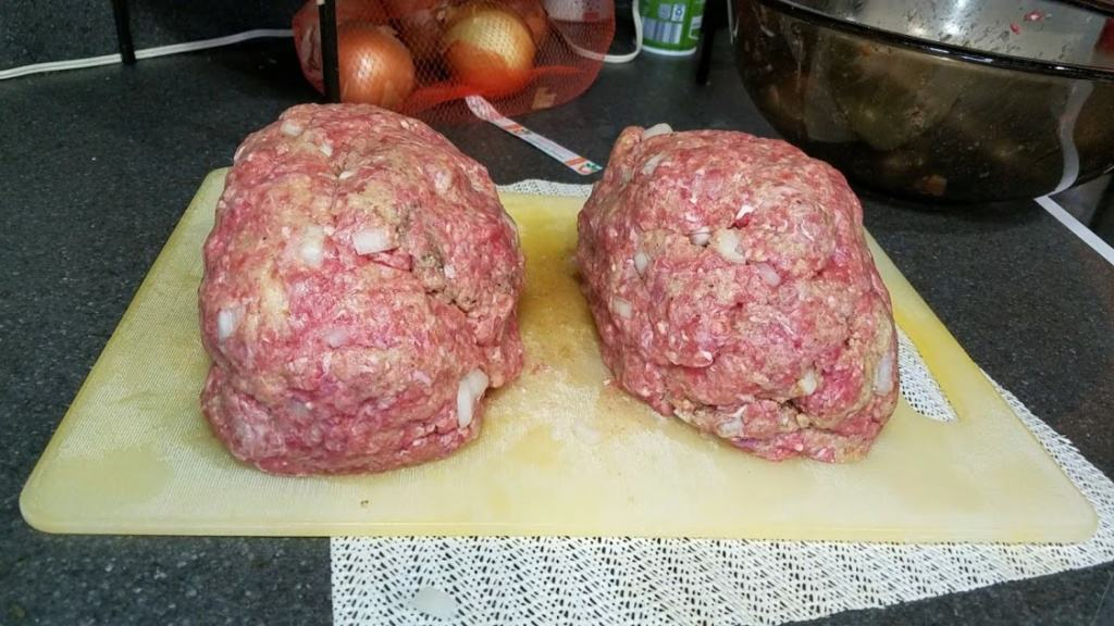 Image of two formed raw meatloaves