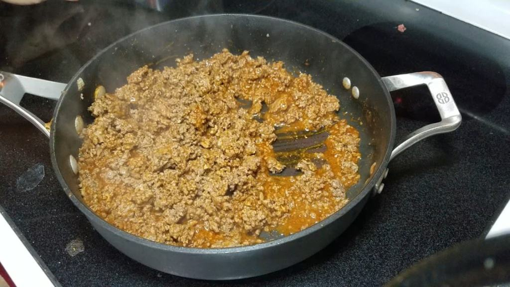 Image of ground beef cooking in a pan