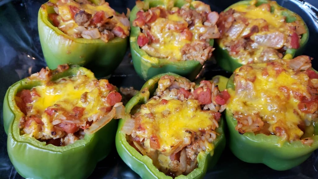Cooked stuffed peppers in a baking pan