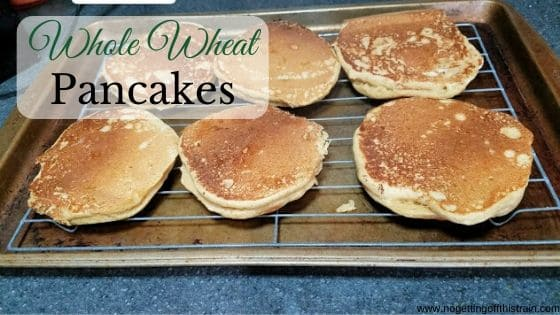 "Image of pancakes on a baking sheet with the title ""Whole wheat pancakes"""