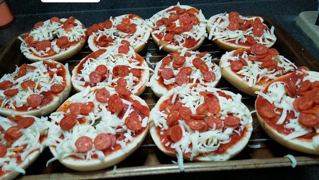 Image of bagel pizzas on a cookie sheet