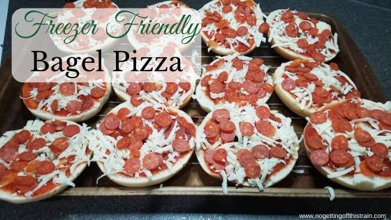 """Image of bagel pizzas on a cookie sheet with the title """"Freezer Friendly Bagel Pizza"""""""