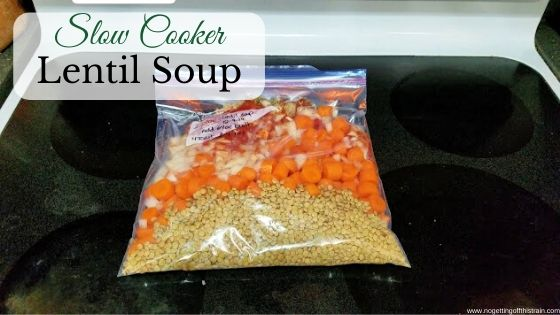"Image of lentil soup in a freezer bag with the title ""Slow cooker lentil soup"""