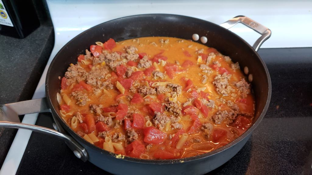 A pan containing the ingredients for Cheesy Beef Skillet