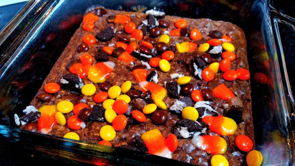 Casserole dish with baked brownies topped with candy