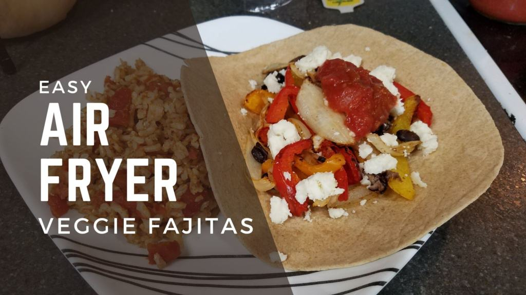 """A plate with fajitas on a tortilla, and Spanish rice. Text that says """"Easy air fryer veggie fajitas"""""""