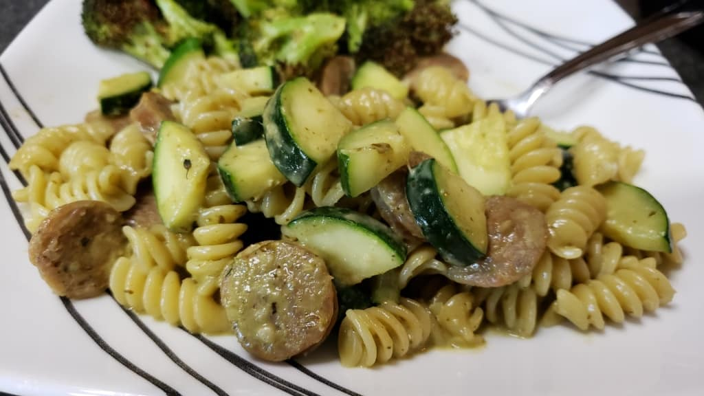 A plate with finished pesto pasta