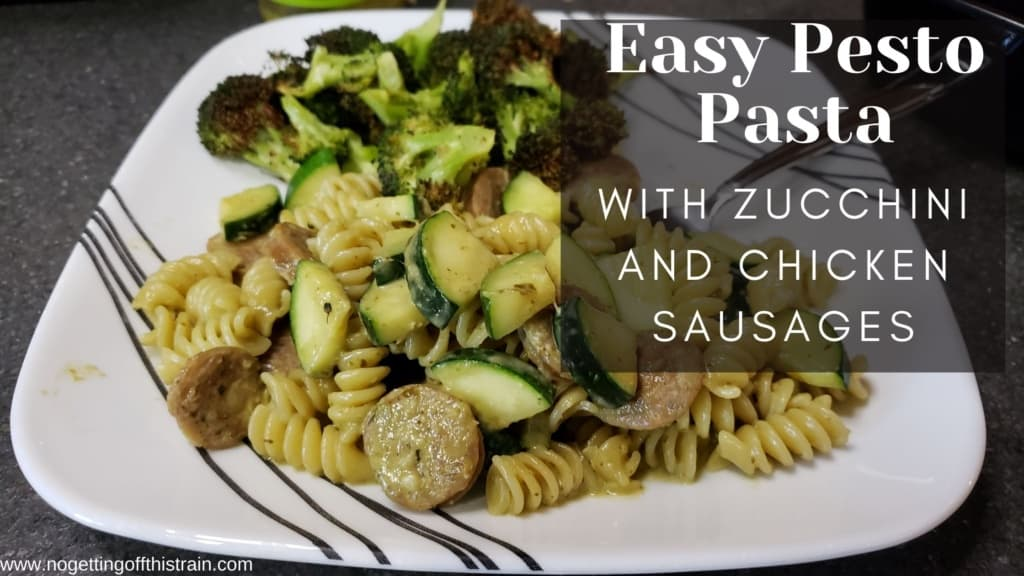 """A plate with pesto pasta with the text """"Pesto Pasta with zucchini and chicken sausages"""""""